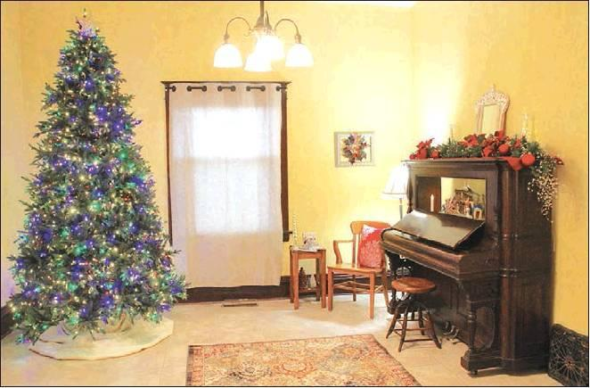 A piano in the former sitting room is similar to one that Byron Starr was known to have played. The piano will be relocated to the other side of the room to make way for construction of a stairway to the second floor.