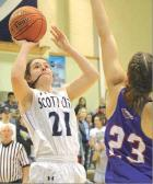 Scott City sophomore Brynn McCormick puts up a jumper over Hugoton's Jordyn Beard during Friday's league win on the home floor. (Record Photo)