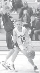 Scott City sophomore Austin Thon drives the baseline during last Friday's home court action against Hugoton. (Record Photo)